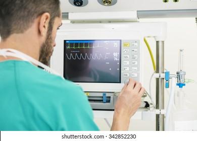 Medical doctor making ECG test in hospital. Medical Concept
