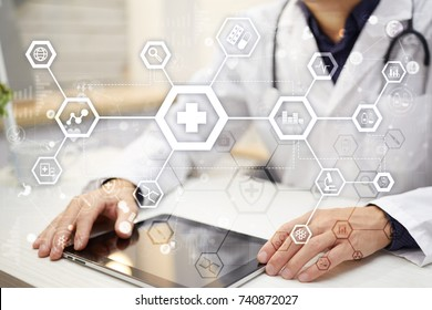 Medical doctor workingwith modern computer virtual screen interface. Medicine technology and healthcare concept.