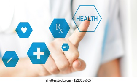 Medical doctor pressing virtual button on modern medical touchscreen by his finger. Concept of modern healthcare and innovition in medicine
