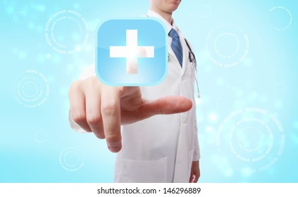 Medical Doctor pushing a blue cross icon over light blue background