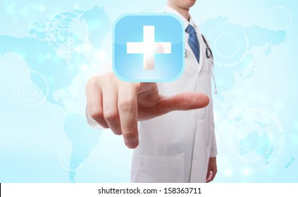Medical Doctor pushing a blue cross icon over world map background