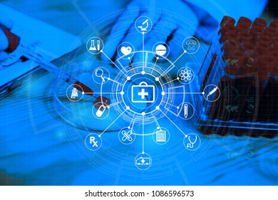medical doctor 's hand  holding blood sample and making notes writing patients data on prescription,lab technician use microscope and test tube in laboratory background with medical icon over