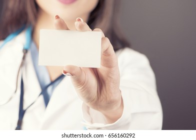 Medical doctor showing business card sign, blank with copy space