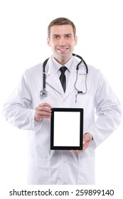 Medical doctor showing digital tablet pc with blank screen.