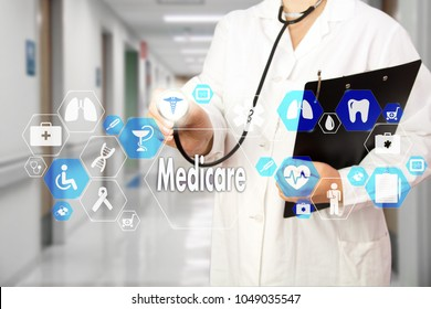 Medical Doctor with stethoscope and Medicare icon in Medical network connection on the virtual screen on hospital background.Technology and medicine concept.