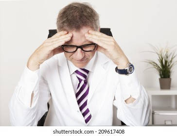 Medical Doctor Suffering Serious Headache from Stress