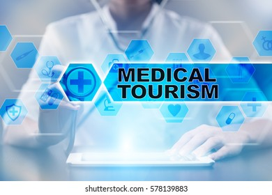 Medical doctor using tablet PC with medical tourism medical concept.
