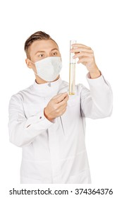 Medical doctor in white coat with stethoscope and mask holding a bottle of urine sample.People and medicine concept. Image isolated on a white background.