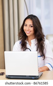 Medical doctor woman with laptop in the office