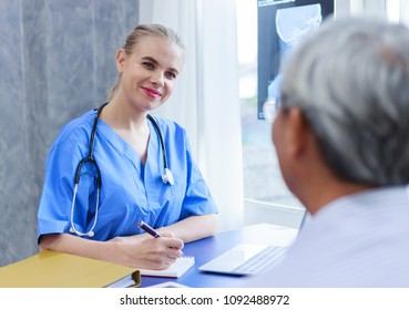 medical doctor woman talking with senior patient and comforting him