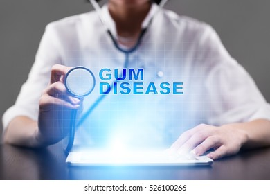 Medical doctor working with modern computer and pressing button gum disease. Medical concept.