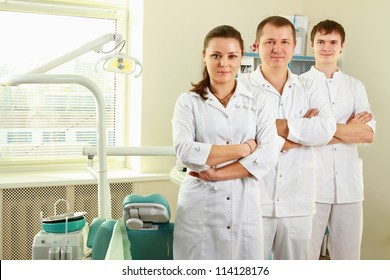 A medical doctors standing in dentist office
