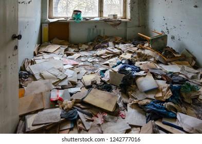 Medical documentation on floor in hospital No. 126, dead abandoned ghost town Pripyat in Chernobyl NPP alienation zone, Ukraine