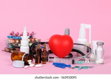 medical drugs and pills on pink ground