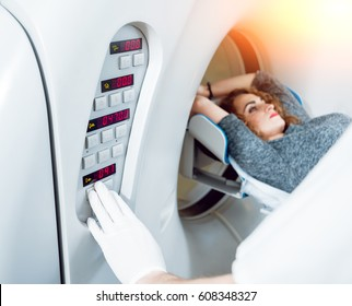 Medical equipment. Doctor and patient in the room of computed tomography at hospital.