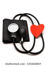 Medical equipment isolate. Tonometer to measure blood pressure. A heart. Help for older people.