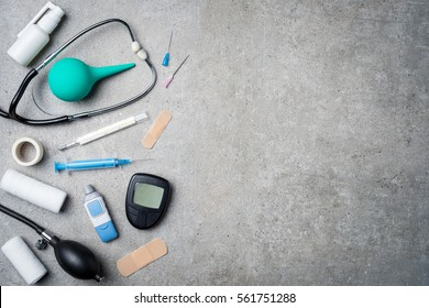 Medical equipment on gray stone background.