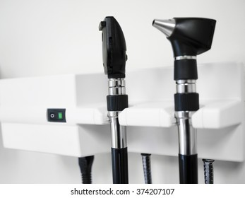 Medical Equipment with otoscope ear scope and ophthalmoscope eye scope hanging on a doctor's office wall