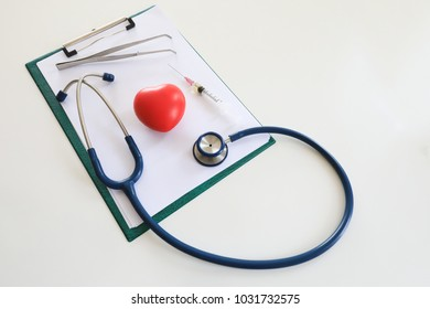 Medical equipment, stethoscope, syringe, red heart on white table. Doctor love, good heart by routine checking with doctor concept. With copyspace.