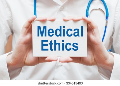 Medical Ethics card in hands of Medical Doctor