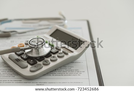 Medical Expenses Plan Or Health Insurance Stethoscope On Calculator With Medical Bill