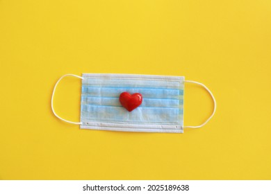 Medical face mask and red heart , covid-19 concept