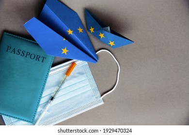 medical face mask,passport, vaccine , paper plane in EU european union flag - concept Coronavirus plans COVID vaccination passport, new flight ban rules travel, aviation business
