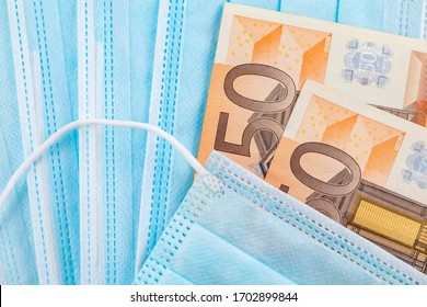 Medical face masks and money. Surgical face mask. COVID-19 Has Caused A Shortage Of Face Masks. Euro banknotes and Medical face masks.