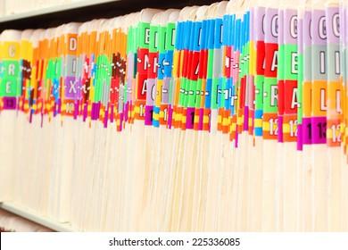 Medical files on a shelf
