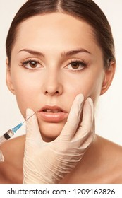 Medical filler for face woman. Anti wrinkle lip injection.