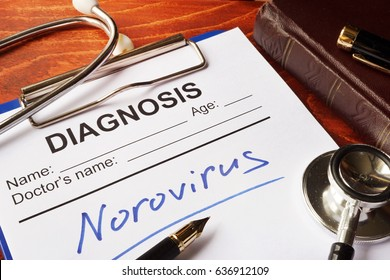 Medical form with diagnosis Norovirus on a table.