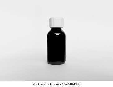 Medical glass Bottle. Medicine bottle of black glass with white cap isolated on white background. Mock up. Ready for your design. Real product packaging. High resolution photo.