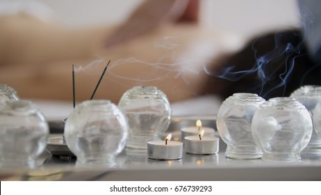 Medical glass cups in the massage room on the background of physiotherapy
