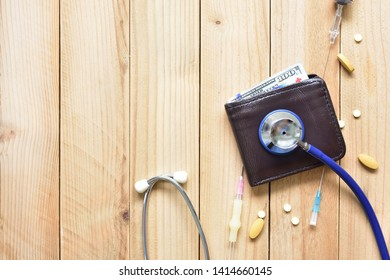 Medical and health money concept,check Health care costs from wallet,Money saving for medical care expenses concept ,Stethoscope Check Health money wallet and care with medicine and hypodermic syringe