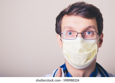 Medical healthcare. Doctor in mask in hospital.  Professional medicine health clinic practitioner. Adult person. People in white uniform coat in lab. Happy confident male. Medical occupation