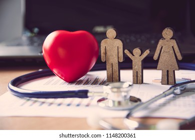 Medical Heart Headsets and Family Icons - Insurance Concepts to Care for Your Family's Medical Costs