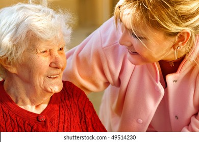 medical helping an old woman