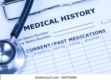 Medical History and Black Stethoscope in Blue White-balance