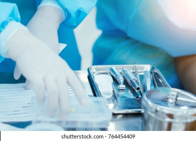 Medical instruments of Doctor in a steel tray.Cleaning of medical instruments after use.Equipment for dentists in hospitals.Dental Clinic.Dental treatment.