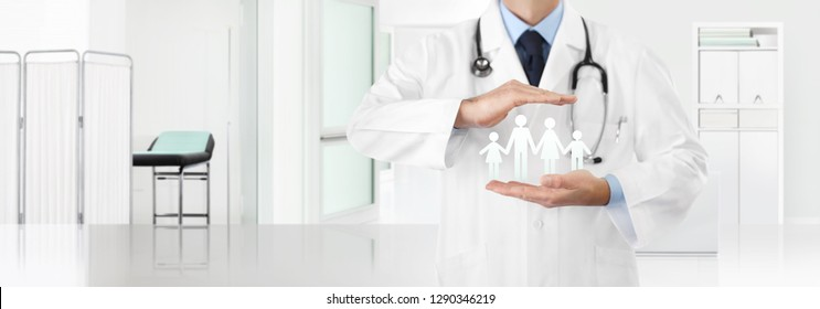 medical insurance concept, doctor's hands protect a family icon with the clinic in the background, copy space and web banner template