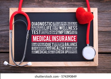 MEDICAL INSURANCE general health word cloud on chalkboard with stethoscope, health concept.