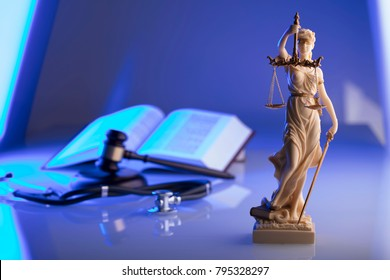 Medical law concept. Gavel, stethoscope, blue light. Place for text.