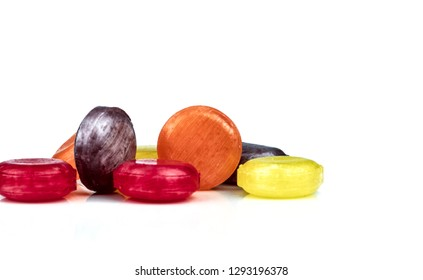 Medical lozenges for relief cough, sore throat and throat irritation isolated on white background. Cough and colds drop. Colorful cough pastille. Red, orange, yellow, and purple round candy or sweets.
