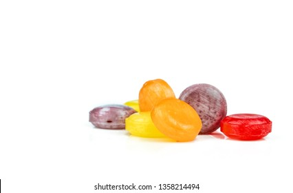 Medical lozenges for relief cough, sore throat and throat irritation isolated on white background. Colorful of cough lozenges. OTC products in pharmacy shop. Orange, red, purple, and yellow lozenges.