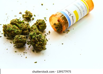 Medical Marijuana A. Medical marijuana pouring out of a prescription bottle against white. (The label on the bottle is original, so no trademark or copyright issues)