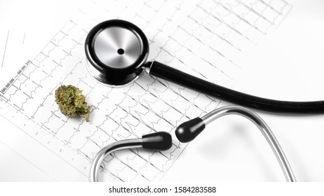 medical marijuana, cannabis bud with cardiolog analytics and stethoscope