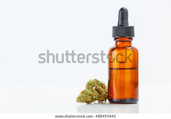 Medical Marijuana Cannabis Oil Extract In Bottle Isolated On White Background With Copy Space. Selective Focus.