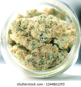 Medical marijuana flower buds. Recreational marijuana strain. Cannabis strain. Weed bud in the glass jar. Dispensary menu. Hemp buds.