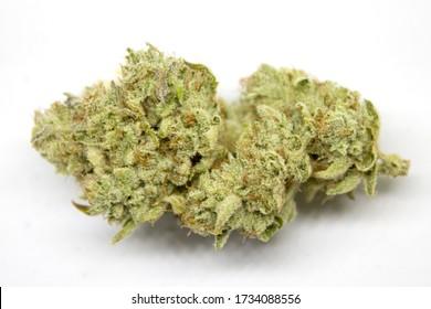 Medical marijuana flower buds. Recreational marijuana strain. Cannabis strain. Weed bud in the glass jar. Dispensary menu. Hemp buds.