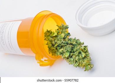 Medical marijuana - a manicured Cannabis bud in a prescription bottle, symbolizing medical marijuana.